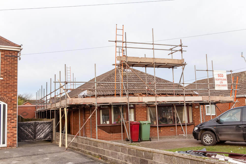roof lift with scaffolding